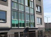 окна тонированные зеленой солнцезащитной пленкой